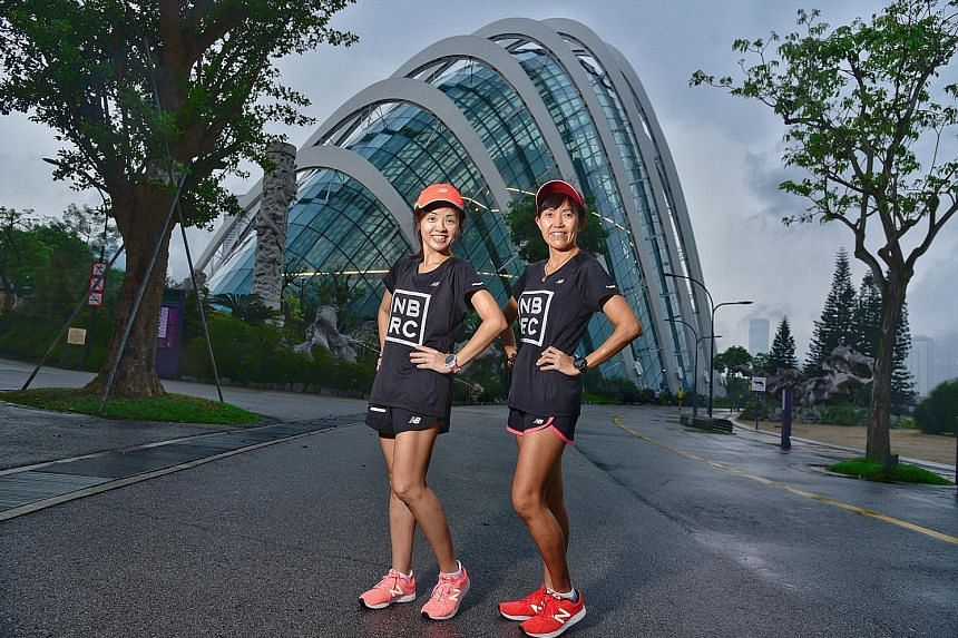 """""""Fast friends"""" Carol Goh (far left) and Connie Liang, seen on the ST Run route outside the Flower Dome in Gardens by the Bay, are among 27 New Balance Running Club members running on Sunday. Both are running in the 18.45km category."""