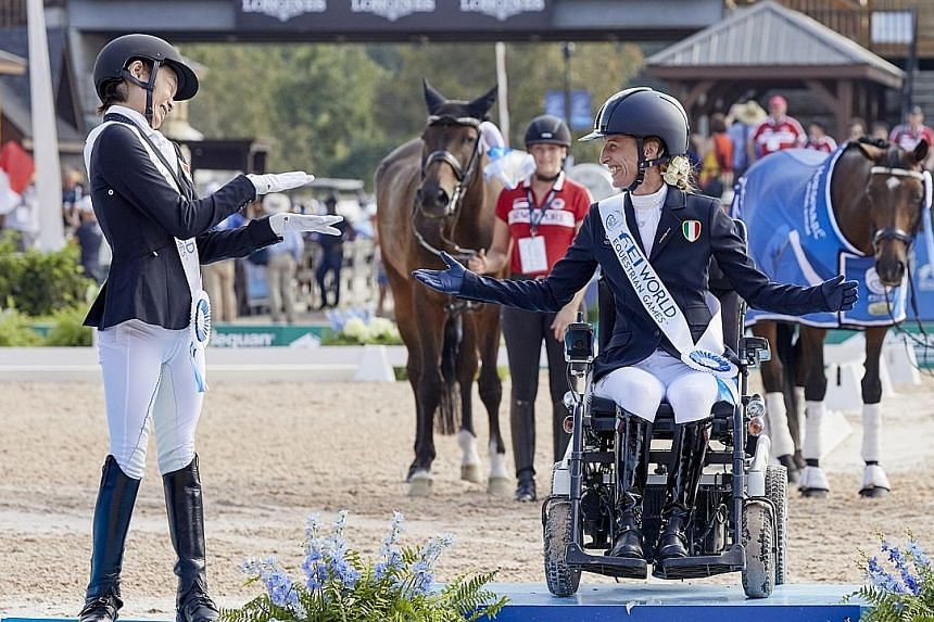Above: Laurentia Tan, with her gelding Fuerst Sherlock, competed in the para-dressage individual championship grade I event at the World Equestrian Games in Tryon, North Carolina, on Wednesday. Left: Tan, who has one silver and three bronze medals fr