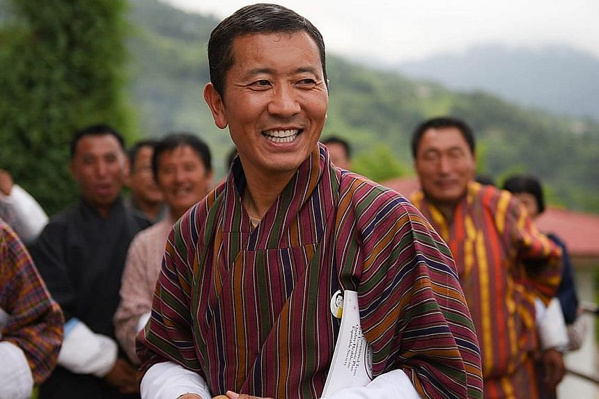 Bhutan's ruling party, led by PM Tshering Tobgay (above), lost in the polls. The most votes went to the party led by Dr Lotay Tshering (left).