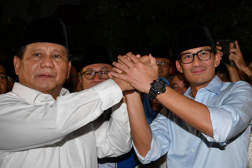 Former general Prabowo Subianto (left) and his running mate Sandiaga Uno when they announced their bid in the 2019 presidential elections in Jakarta, on Aug 9, 2018.