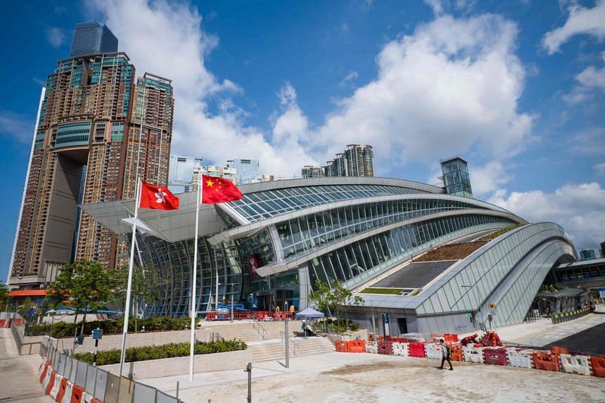 The flags of Hong Kong (left) and China are seen hoisted outside the West Kowloon train station of the High Speed Rail Link in Hong Kong, on Sept 10, 2018.