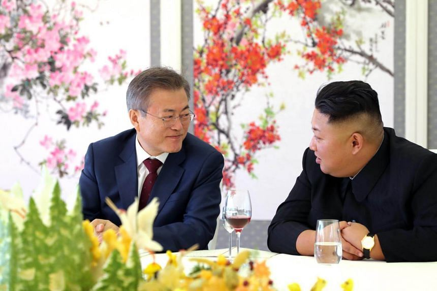 South Korean president Moon Jae-in (left) talking to North Korean leader Kim Jong Un as they visit at the Samjiyon guesthouse in North Korea, on Sept 20, 2018.