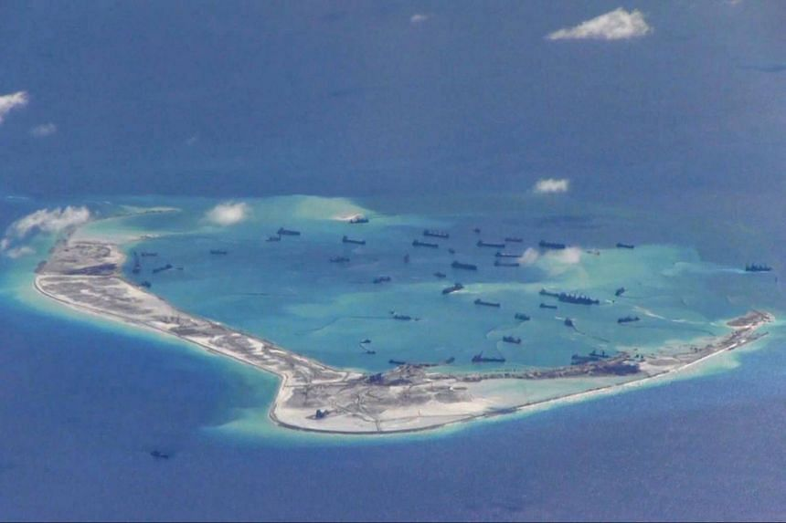 File photo of Chinese dredging vessels purportedly seen in the waters around Mischief Reef in the disputed Spratly Islands in the South China Sea, on May 21, 2015.