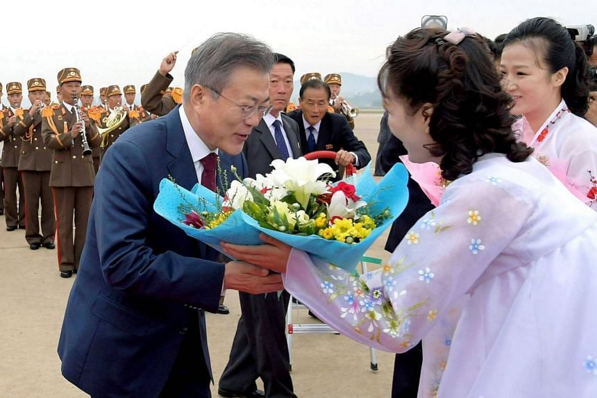 South Korean President Moon Jae-in receives flowers at an airport in North Korea, on Sept 21, 2018.