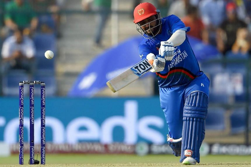 Afghan batsman Mohammad Shahzad plays a shot during the one day international Asia Cup cricket match between Bangladesh and Afghanistan at the Sheikh Zayed Stadium in Abu Dhabi, on Sept 20, 2018.