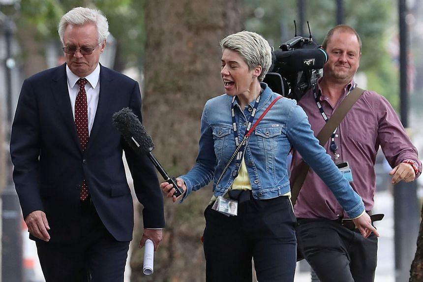 David Davis is questioned by a BBC reporter as he arrives to attend a Brexit meeting in London, Sept 12, 2018.