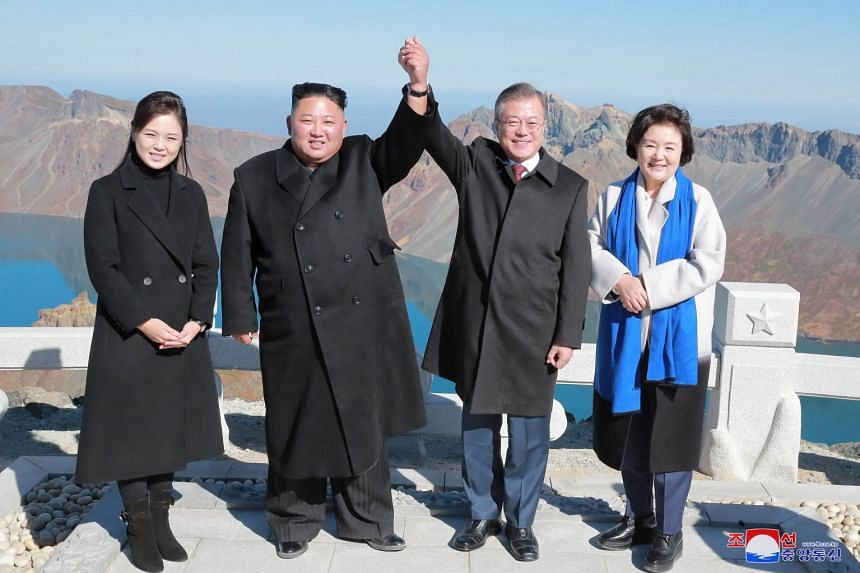 South Korean President Moon Jae-in and his wife Kim Jung-sook (right) pose with North Korean leader Kim Jong Un and his wife Ri Sol Ju on the top of Mount Baekdu in North Korea on Sept 20, 2018.