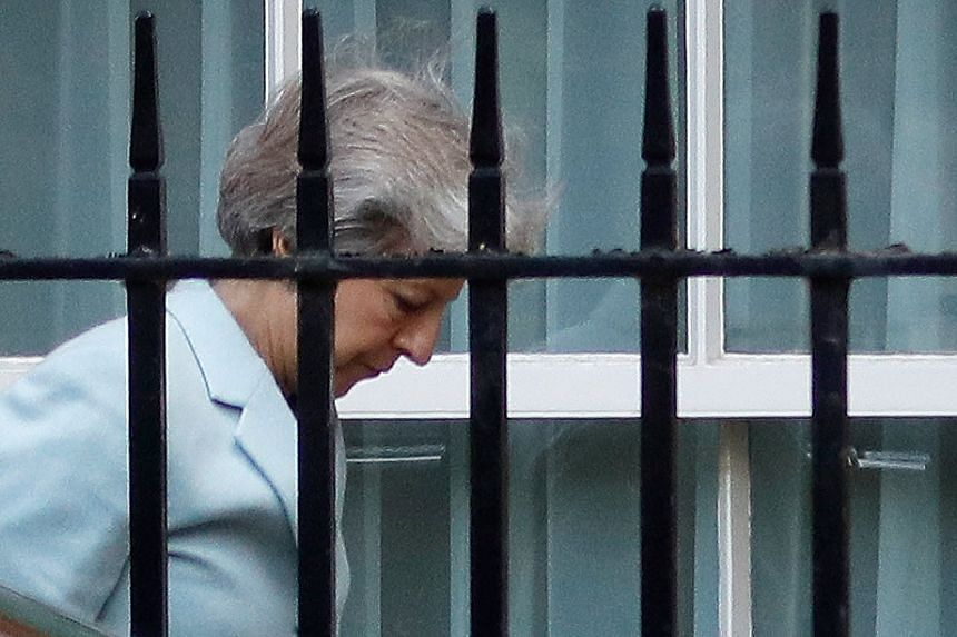 Britain's Prime Minister Theresa May arriving at the back entrance of No. 10 Downing Street in London, on Sept 21, 2018.