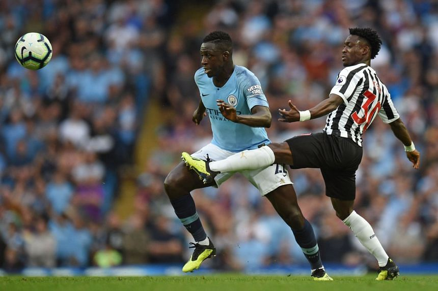 Mendy in action (left) against Newcastle United's Ghanaian midfielder Christian Atsu.