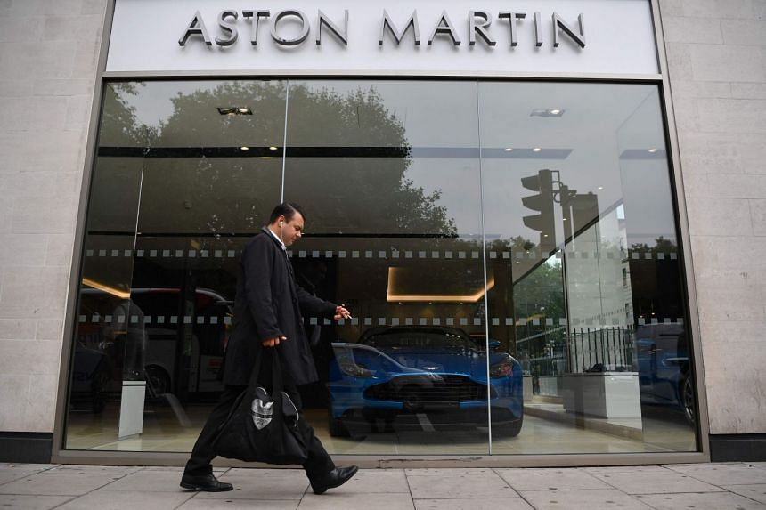 An Aston Martin showroom in central London. The luxury carmaker, which has long said it could pursue a listing, has undergone a turnaround plan since Mr Andy Palmer took over as chief executive officer in 2014 as it boosts its volumes and expands int