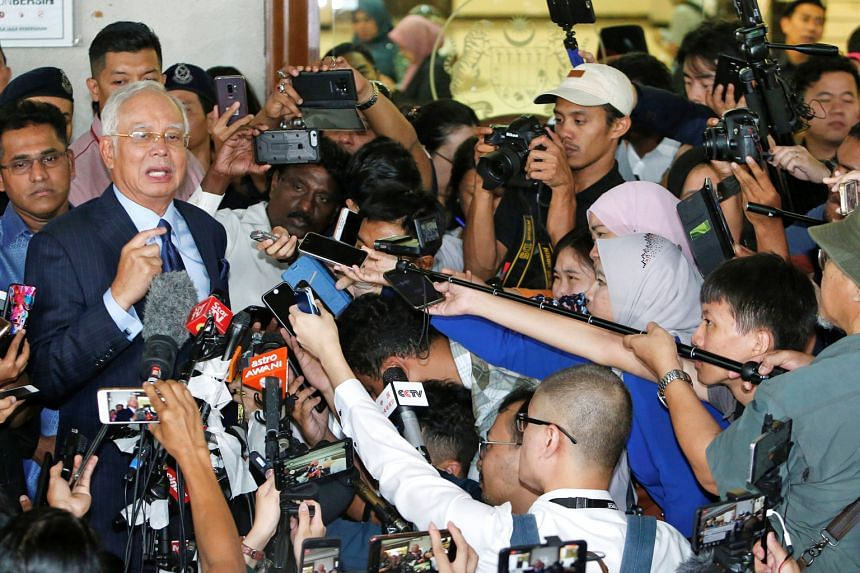 Najib Razak speaking to the media at a Kuala Lumpur court yesterday. He told reporters that the court case would be an opportunity for him to clear his name. The charges filed against the former leader at his third court appearance were related to th