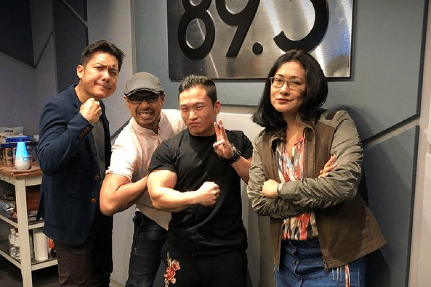 In The Hot Seat, the Money FM crew pin down the founder of Singapore Pro Wrestling, Andruew Tang (second from right), on how he grapples with the business side of the sport and what he's doing to make it more popular.