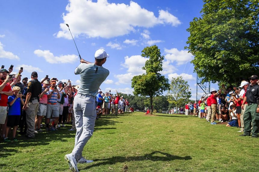 Woods hits from outside the ropes on the eighth hole during the second round.
