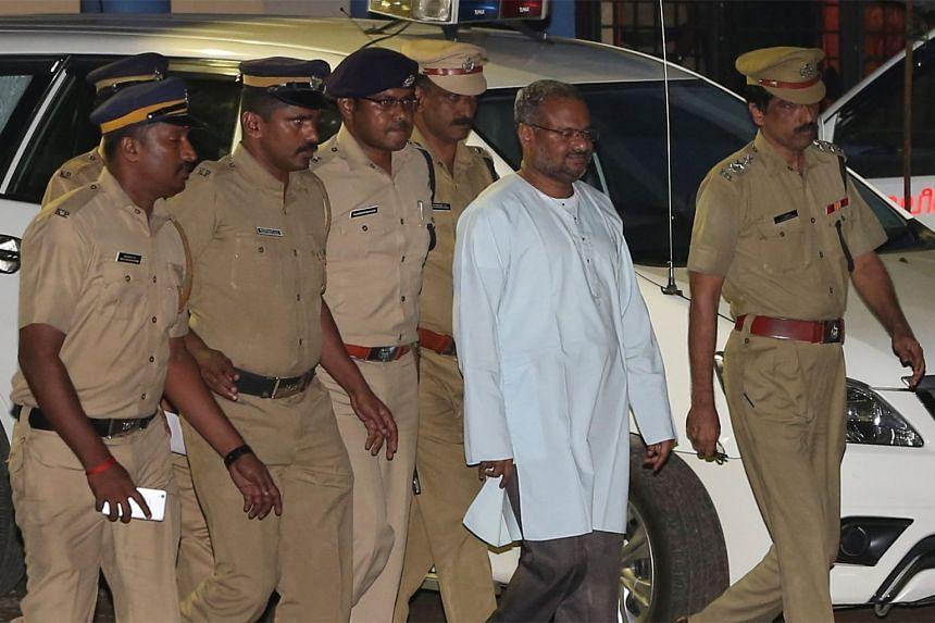 Bishop Franco Mulakkal (second right) is escorted by police officers in Kochi, Kerala, Sept 21, 2018.