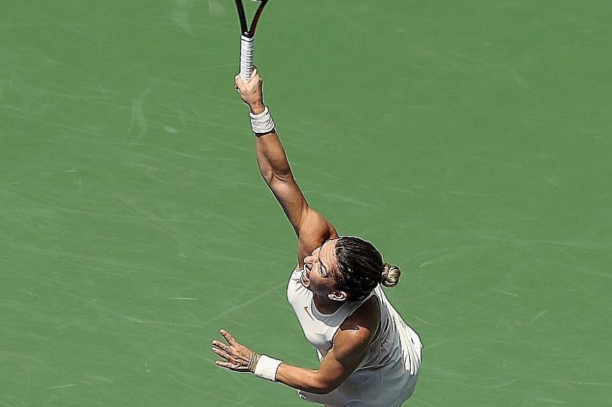 Simona Halep serving during her shock first-round loss to Estonia's Kaia Kanepi at the US Open.