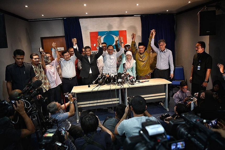 Datuk Seri Anwar Ibrahim and his wife, Datuk Seri Dr Wan Azizah Wan Ismail, with other PKR leaders at the press conference yesterday.