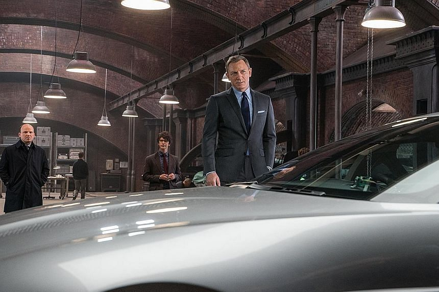 Actor Daniel Craig (above, in Spectre, 2015) will reprise his role as 007 in the new film, while Cary Fukunaga (left), the franchise's first non-British director, will helm it.