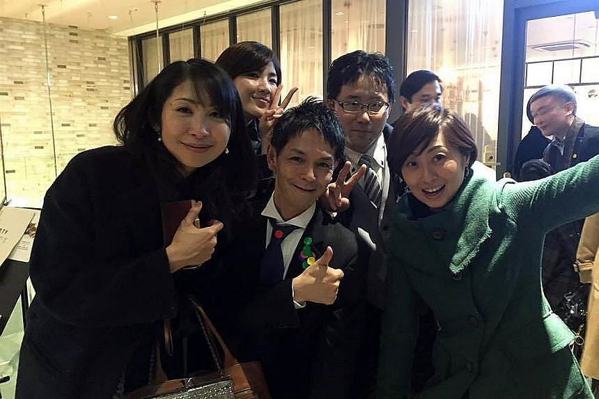 """Mr Nobuaki Tanaka (centre, in black tie), 48, an """"ossan"""" for rent, was once """"rented"""" as a party companion."""