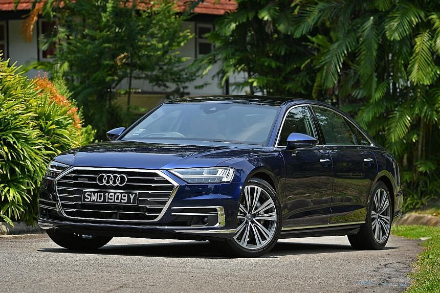 Exquisitely furnished and finished, with open-pore wood veneer and lush leather, the Audi A8 also has black mirror touchscreens on the fascia and a fully digital instrument panel behind the wheel.