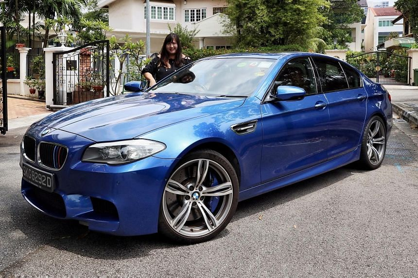 Ms Pearl Teo's BMW M5 is a hand-me-down from her husband, who chose it for its performance and four-door comfort and practicality.
