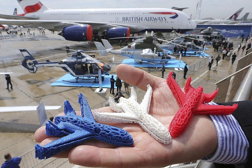 Aeroplane models (left) printed with 3D technology. The aerospace industry in Singapore wants to tap this technology, which will allow components to be produced in a single piece, instead of having to assemble different parts.