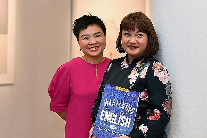 Straits Times Press general manager Susan Long (far left) and The Straits Times Schools team's Debra Ann Francisco with the workbook, Mastering English With The Straits Times: The Secondary Edition, which won Best Education Title.