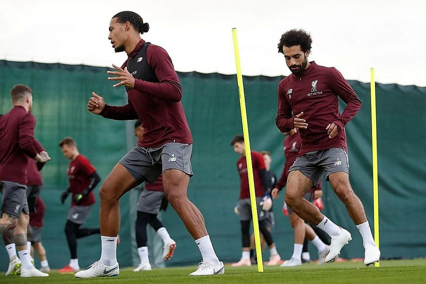 """Liverpool's defender Virgil van Dijk (far left) and fellow """"defender"""" Mohamed Salah during training in midweek. Manager Jurgen Klopp said that """"on the defensive side, (Salah) was outstanding in the last two games... That says everything about him, th"""