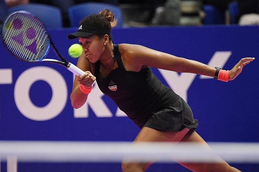 Japan's Naomi Osaka hitting a return against Barbora Strycova in the Pan Pacific Open quarter-finals. The US Open champion was not at her best but still won 6-3, 6-4.