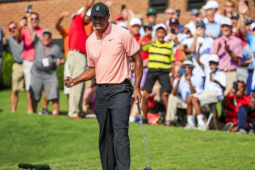 The roaring good times are back, with the crowd cheering Tiger Woods after his eagle on the 18th in the Tour Championship first round at East Lake Golf Club in Atlanta, Georgia, on Thursday.