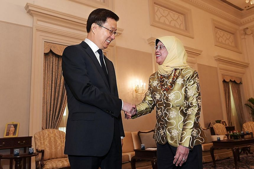 Chinese Vice-Premier Han Zheng meeting President Halimah Yacob (above) and Prime Minister Lee Hsien Loong (right) at the Istana yesterday. The three leaders said they look forward to the conclusion of the China-Singapore Free Trade Agreement negotiat