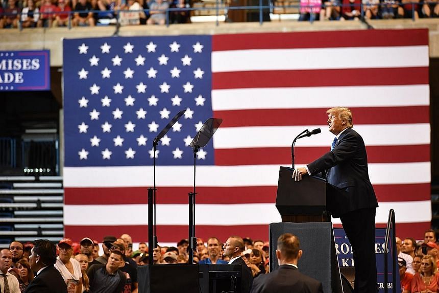 Mr Barack Obama (above, at a rally in Anaheim, California) is campaigning with the message #TakeItBack; while US President Donald Trump (left, at a rally in Wilkes-Barre, Pennsylvania) leads the charge for Republican candidates.