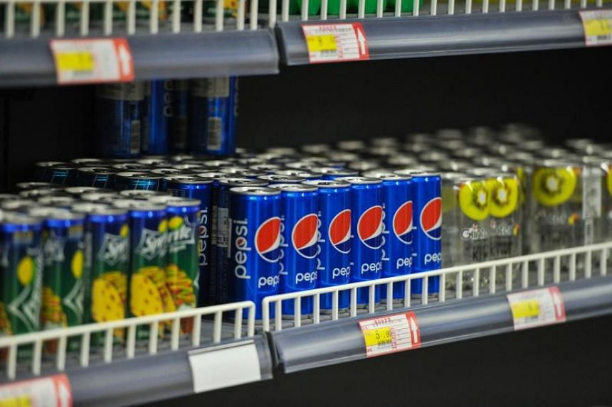 Cans of imported US drinks are displayed in a store in Qingdao in China's eastern Shandong province on Sept 19, 2018.