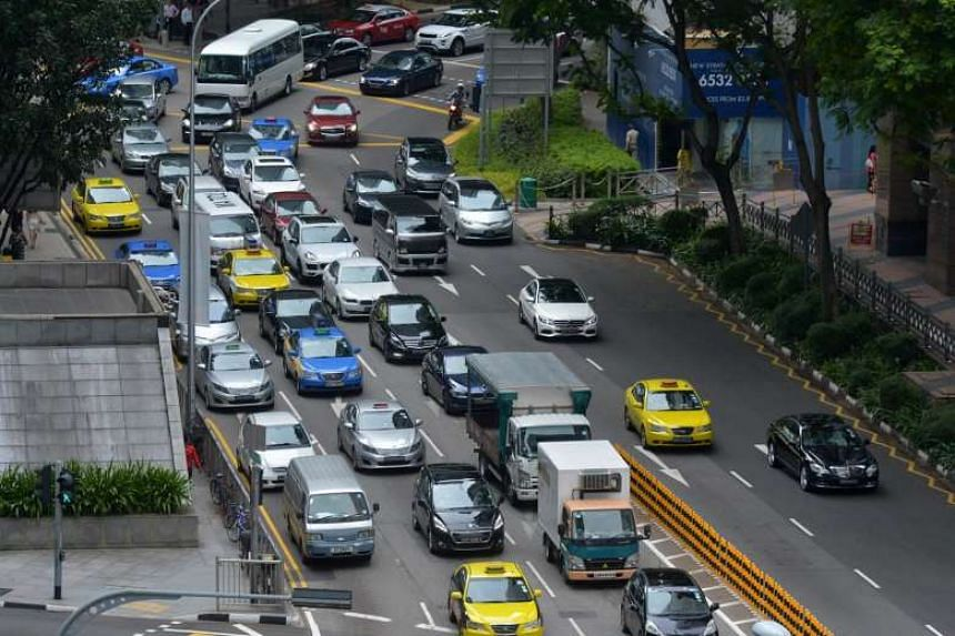 File photo showing cars along One Marina Boulevard on March 22, 2016.