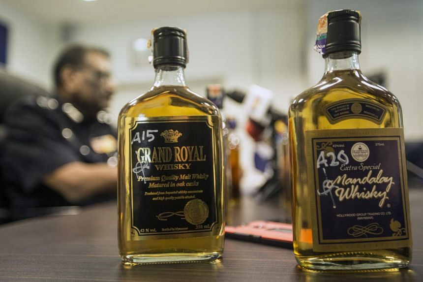 Confiscated alcoholic liquors on display at a press conference in Kuala Lumpur on Sept 19, 2018.