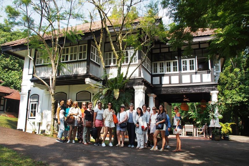 The tour group - a mix of expatriates and visitors - outside a black-and-white bungalow in Nassim Road as part of a Crazy Rich Asians tour led by Jane's Singapore Tours, on Sept 14, 2018.