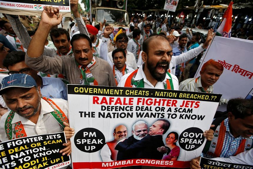 Supporters of India's main opposition Congress Party shout slogans during a protest demanding from government to disclose the details of Rafale fighter planes deal, in Mumbai, India, on July 30, 2018.