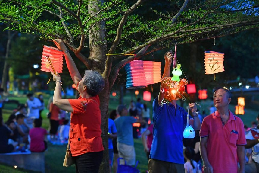 Residents penned their thoughts and well wishes for their loved ones on lanterns, which were lit and hung from trees.