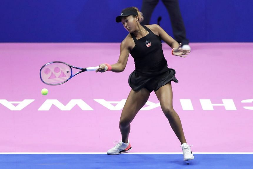 Naomi Osaka of Japan in action against Camila Giorgi of Italy during their singles semi-final match of the Pan Pacific Open women's tennis tournament in Tachikawa, Japan, on Sept 22, 2018.