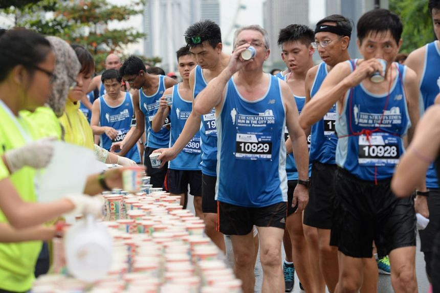 Participants at the drinks station at the ST Run in The City 2016. The Straits Times Run 2018 will take place on Sept 23.