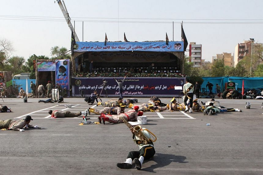 Injured soldiers lying on the ground at the scene of an attack on a military parade in Ahvaz, Iran, on Sept 22, 2018.