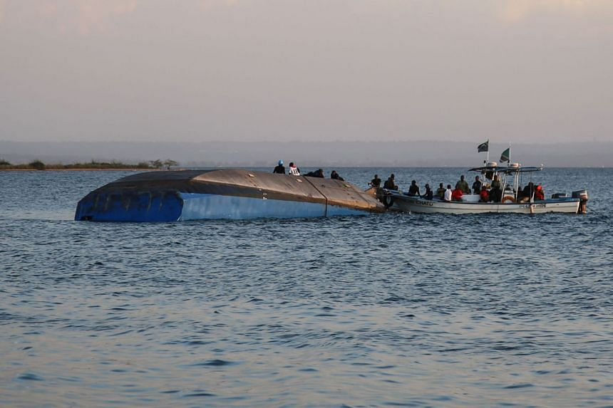 Investigators work on the capsized ferry MV Nyerere which killed 131 people in Lake Victoria, Tanzania, on Sept 21, 2018.