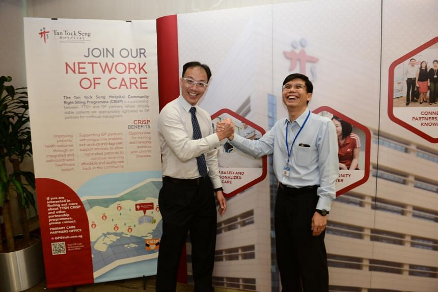 Adjunct Associate Professor David Foo (left), Clinical Lead for Primary Care at TTSH and Dr Eng Soo Kiang of Unity Family Medicine Clinic shake hands to signify the partnership between the hospital and primary care partners at TTSH on Sept 22, 2018.