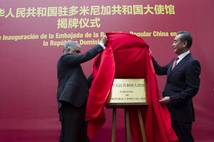 Dominican Foreign Minister Miguel Vargas (left) and his Chinese counterpart, Wang Yi, attending the inauguration of the first Chinese Embassy in the Dominican Republic, on Sept 21, 2018.