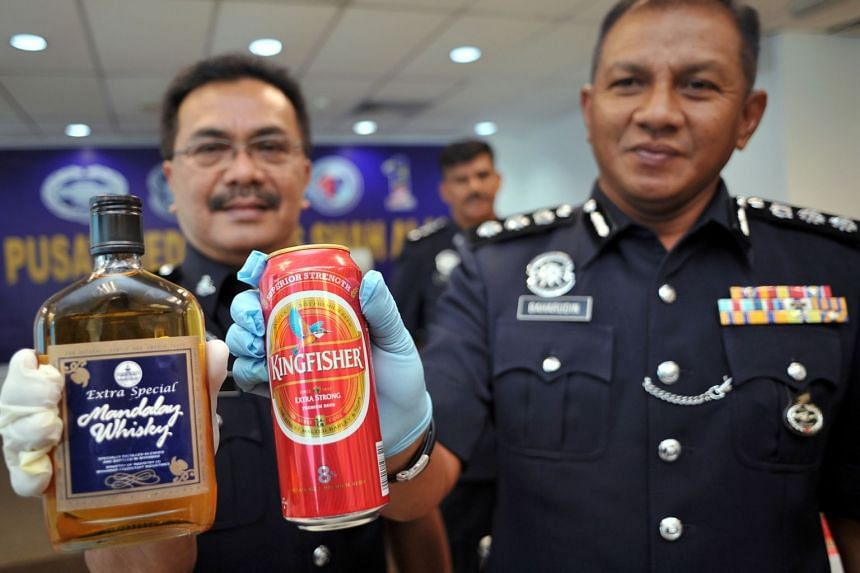 Malaysian police said that 1,021 bottles of alcoholic beverages and 1,695 beer cans were seized in 13 raids.