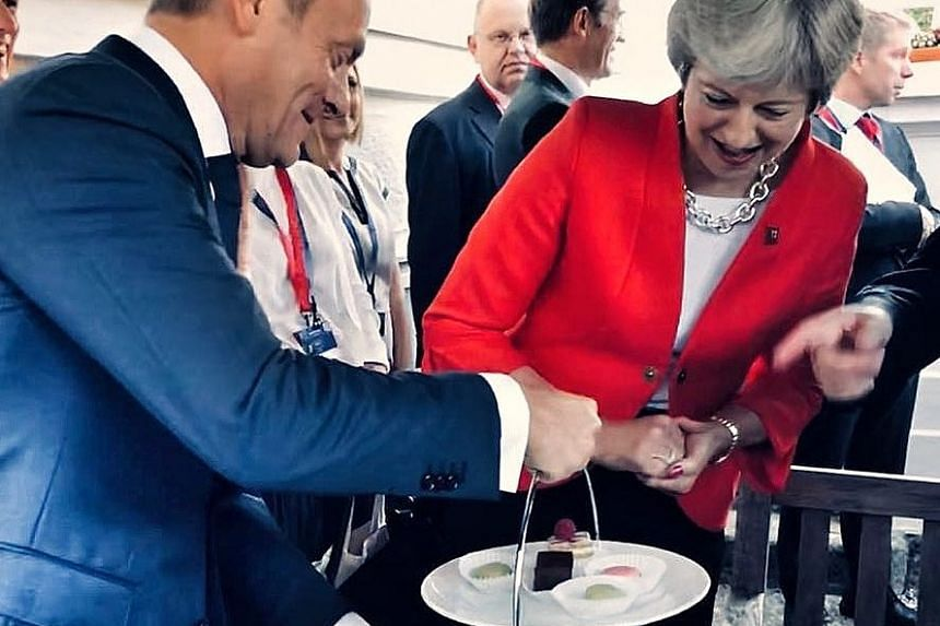 """Tusk created a mini-sensation during a difficult EU summit on Brexit with his """"no cherries"""" Instagram photo."""