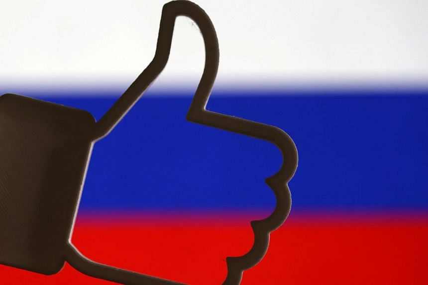 A 3D-printed Facebook like button is seen in front of a Russian flag in a photo taken Oct 25, 2017.