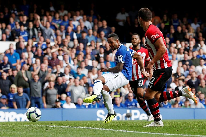 Everton's Theo Walcott has a shot at goal.