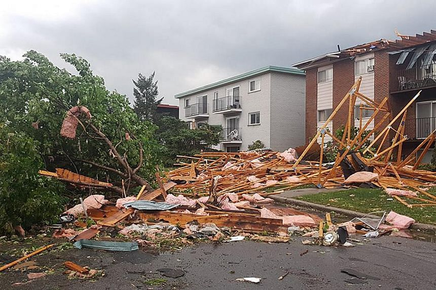 Destroyed buildings and cars are seen in Mont-Bleu, Gatineau, Quebec, close to Ottawa after a tornado shattered Canada's capital on Sept 21, 2018.