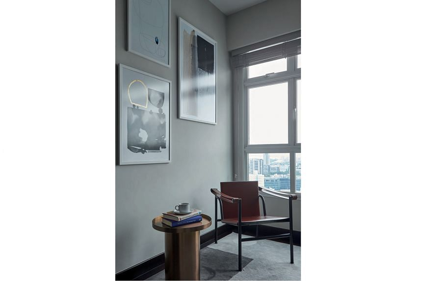 Shades of grey are used on walls to create a complementary backdrop for the owners' collection of artworks (above) as well as on storage units for a chic look.