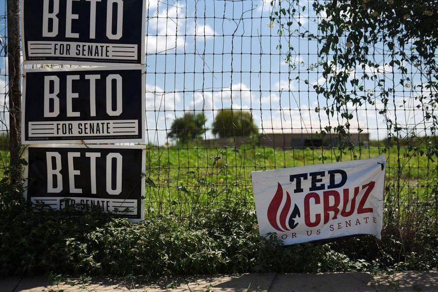 Ted Cruz and Beto O'Rourke election signs are seen near downtown Carizzo Springs, Texas. A fresh poll released this week put Democrat Mr O'Rourke, who has steadily closed the gap over the past few months, in the lead for the first time. If he get